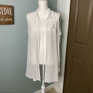 Long white button-up, high-low, sleeveless blouse